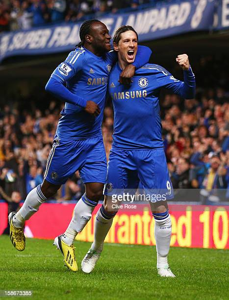 Fernando Torres of Chelsea celebrates with Victor Moses as he scores their first goal during the Barclays Premier League match between Chelsea and...