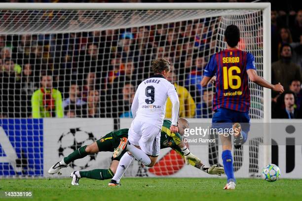 Fernando Torres of Chelsea CF scores his team's second goal under a challenge by goalkeeper Victor Valdes of FC Barcelona during the UEFA Champions...