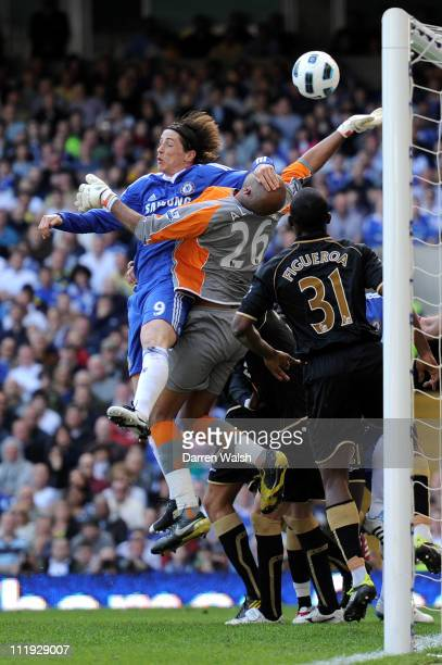 Fernando Torres of Chelsea challenges goalkeeper Ali Al Habsi of Wigan during the Barclays Premier League match between Chelsea and Wigan Athletic at...
