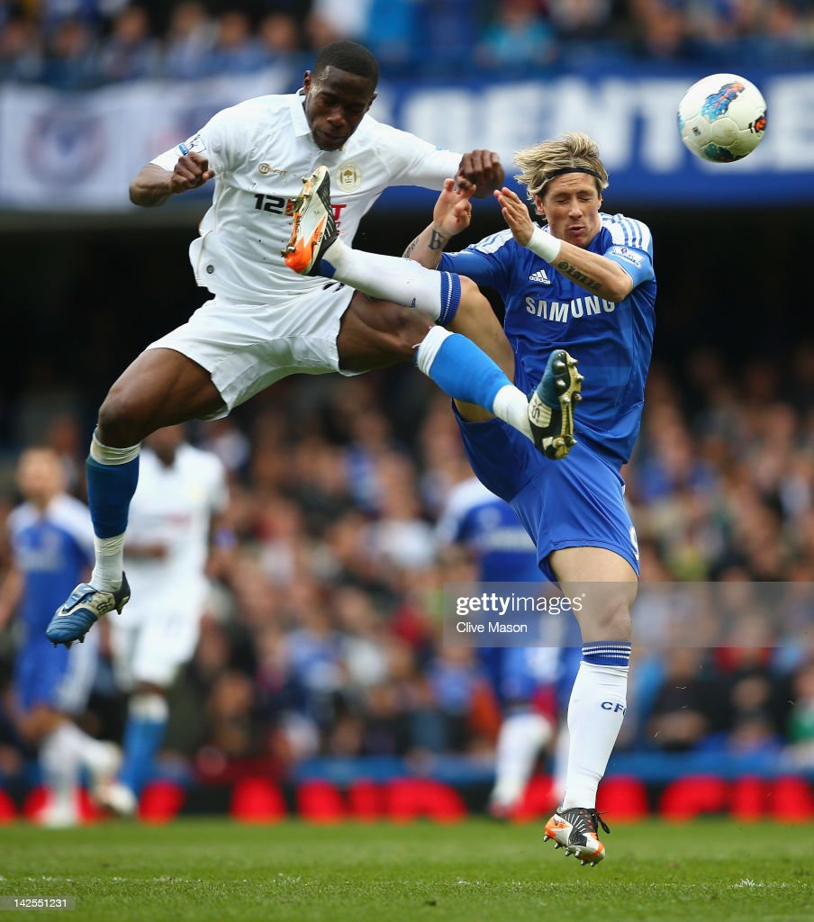 <a gi-track='captionPersonalityLinkClicked' href=/galleries/search?phrase=Fernando+Torres&family=editorial&specificpeople=194755 ng-click='$event.stopPropagation()'>Fernando Torres</a> of Chelsea challenges <a gi-track='captionPersonalityLinkClicked' href=/galleries/search?phrase=Maynor+Figueroa&family=editorial&specificpeople=882234 ng-click='$event.stopPropagation()'>Maynor Figueroa</a> of Wigan Athletic during the Barclays Premier League match between Chelsea and Wigan Athletic at Stamford Bridge on April 7, 2012 in London, England.