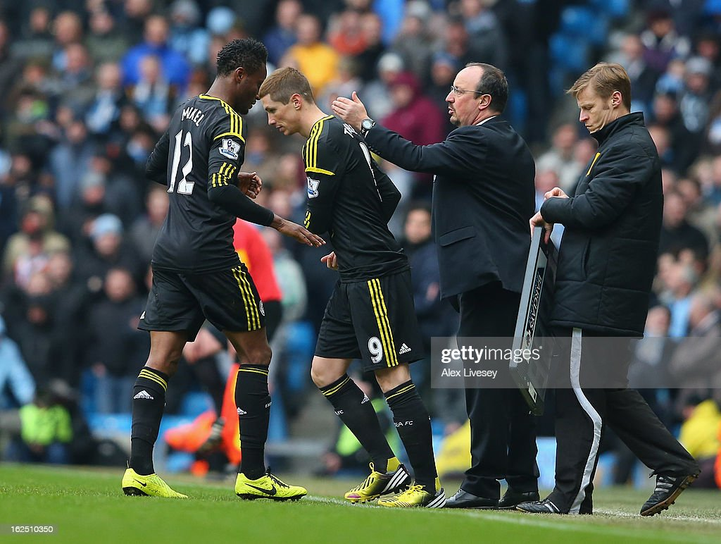 Fernando Torres of Chelsea comes on for John Obi Mikel as Rafa Benitez the manager of Chelsea makes a substitution during the Barclays Premier League match between Manchester City and Chelsea at Etihad Stadium on February 24, 2013 in Manchester, England.