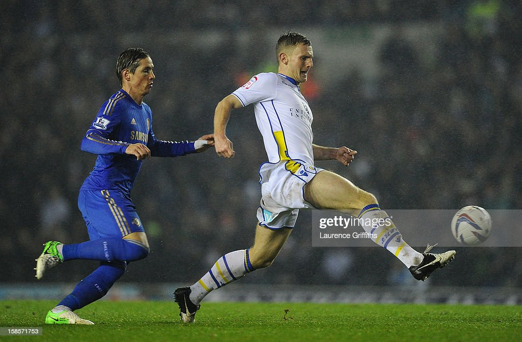 Fernando Torres of Chelsea competes with Tom Lees of Leeds United during the Capital One Cup Quarter-Final match between Leeds United and Chelsea at Elland Road on December 19, 2012 in Leeds, England.