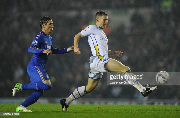 Fernando Torres of Chelsea competes with Tom Lees of Leeds United during the Capital One Cup QuarterFinal match between Leeds United and Chelsea at...