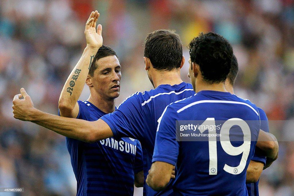 Fernando Torres (L) of Chelsea congratulates goal scorer, Nemanja Matic (C) during the pre season friendly match between Vitesse Arnhem and Chelsea at the Gelredome Stadium on July 30, 2014 in Arnhem, Netherlands.