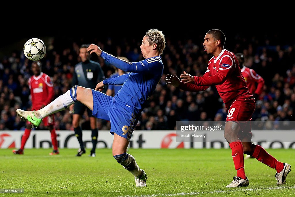 <a gi-track='captionPersonalityLinkClicked' href=/galleries/search?phrase=Fernando+Torres&family=editorial&specificpeople=194755 ng-click='$event.stopPropagation()'>Fernando Torres</a> of Chelsea controls the ball as Patrick Mtiliga FC Nordsjaelland closes in during the UEFA Champions League group E match between Chelsea and FC Nordsjaelland at Stamford Bridge on December 5, 2012 in London, England.