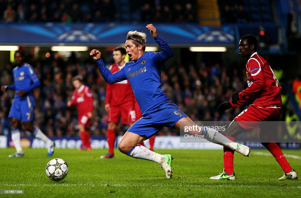<a gi-track='captionPersonalityLinkClicked' href=/galleries/search?phrase=Fernando+Torres&family=editorial&specificpeople=194755 ng-click='$event.stopPropagation()'>Fernando Torres</a> of Chelsea gooes down following contact with Enoch Adu FC Nordsjaelland during the UEFA Champions League group E match between Chelsea and FC Nordsjaelland at Stamford Bridge on December 5, 2012 in London, England.