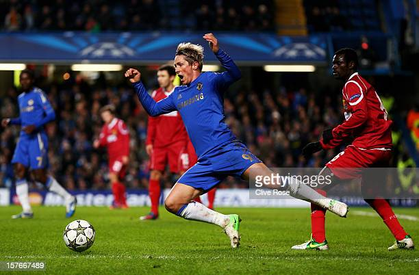Fernando Torres of Chelsea gooes down following contact with Enoch Adu FC Nordsjaelland during the UEFA Champions League group E match between...