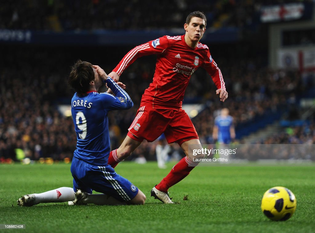 <a gi-track='captionPersonalityLinkClicked' href=/galleries/search?phrase=Fernando+Torres&family=editorial&specificpeople=194755 ng-click='$event.stopPropagation()'>Fernando Torres</a> of Chelsea holds his face after a is challenge by <a gi-track='captionPersonalityLinkClicked' href=/galleries/search?phrase=Daniel+Agger&family=editorial&specificpeople=605441 ng-click='$event.stopPropagation()'>Daniel Agger</a> of Liverpool during the Barclays Premier League match between Chelsea and Liverpool at Stamford Bridge on February 6, 2011 in London, England.