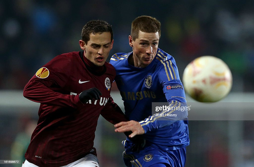 <a gi-track='captionPersonalityLinkClicked' href=/galleries/search?phrase=Fernando+Torres&family=editorial&specificpeople=194755 ng-click='$event.stopPropagation()'>Fernando Torres</a> of Chelsea (R) in action with Mario Holek of Sparta Praha during the UEFA Europa League match between AC Sparta Praha and Chelsea on February 14, 2013 in Prague, Czech Republic.