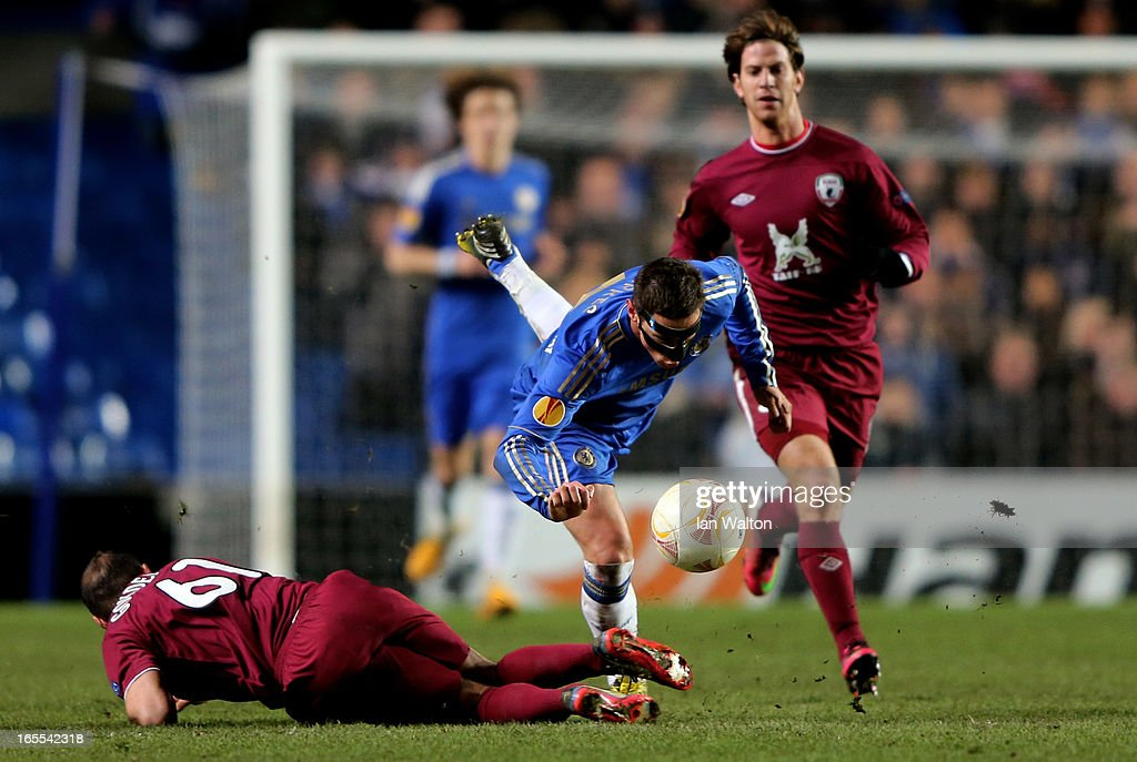 <a gi-track='captionPersonalityLinkClicked' href=/galleries/search?phrase=Fernando+Torres&family=editorial&specificpeople=194755 ng-click='$event.stopPropagation()'>Fernando Torres</a> of Chelsea is brought down by <a gi-track='captionPersonalityLinkClicked' href=/galleries/search?phrase=Gokdeniz+Karadeniz&family=editorial&specificpeople=2360972 ng-click='$event.stopPropagation()'>Gokdeniz Karadeniz</a> of Rubin Kazan during the UEFA Europa League quarter final first leg match between Chelsea and FC Rubin Kazan at Stamford Bridge on April 4, 2013 in London, England.