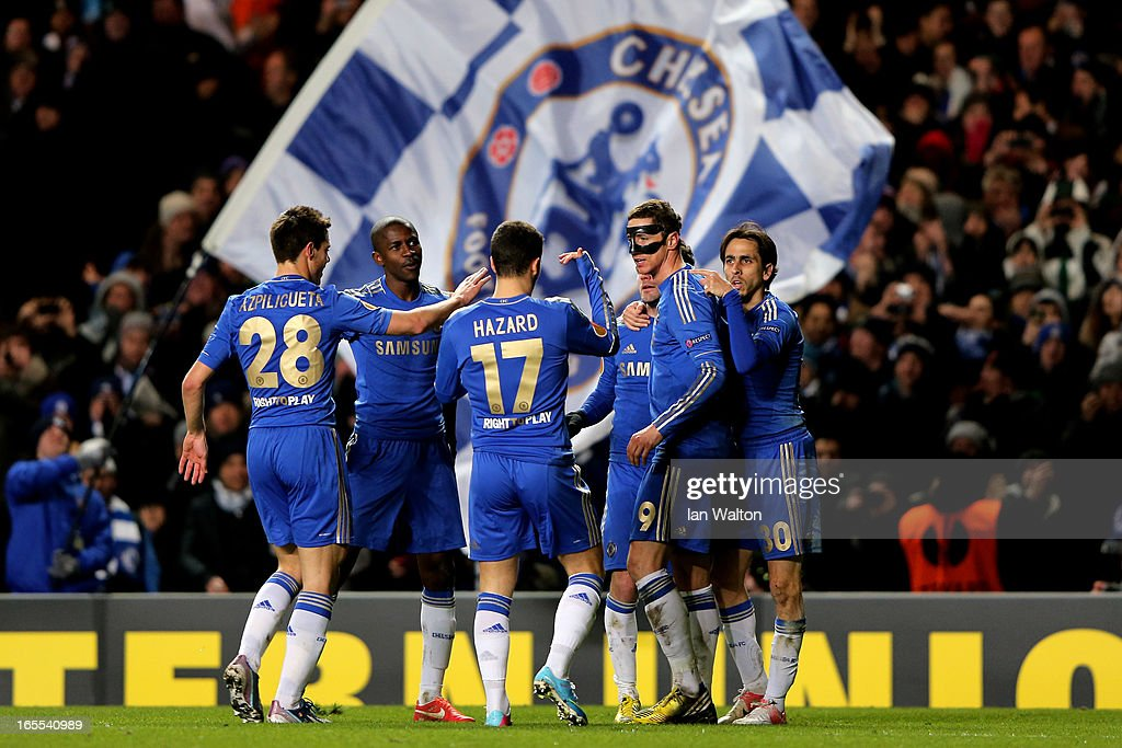 <a gi-track='captionPersonalityLinkClicked' href=/galleries/search?phrase=Fernando+Torres&family=editorial&specificpeople=194755 ng-click='$event.stopPropagation()'>Fernando Torres</a> #9 of Chelsea is congratulated by teammates after scoring his team's third goal with a header during the UEFA Europa League quarter final first leg match between Chelsea and FC Rubin Kazan at Stamford Bridge on April 4, 2013 in London, England.