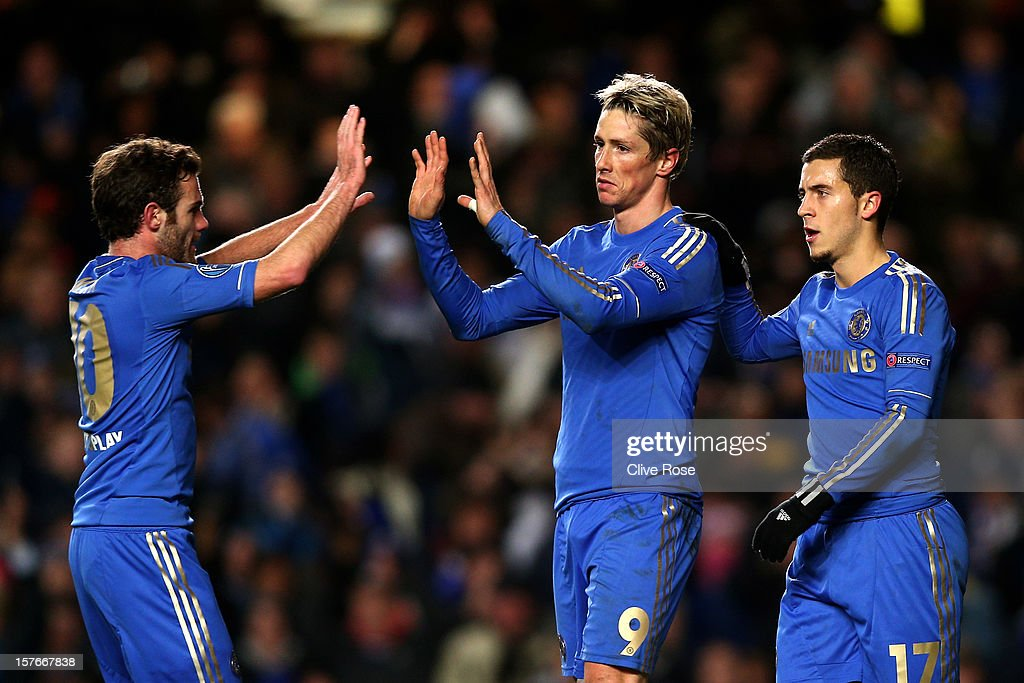 <a gi-track='captionPersonalityLinkClicked' href=/galleries/search?phrase=Fernando+Torres&family=editorial&specificpeople=194755 ng-click='$event.stopPropagation()'>Fernando Torres</a> of Chelsea is congratulated by teammates <a gi-track='captionPersonalityLinkClicked' href=/galleries/search?phrase=Juan+Mata&family=editorial&specificpeople=4784696 ng-click='$event.stopPropagation()'>Juan Mata</a> (L) and <a gi-track='captionPersonalityLinkClicked' href=/galleries/search?phrase=Eden+Hazard&family=editorial&specificpeople=5539543 ng-click='$event.stopPropagation()'>Eden Hazard</a> (R) after scoring his team's second goal during the UEFA Champions League group E match between Chelsea and FC Nordsjaelland at Stamford Bridge on December 5, 2012 in London, England.