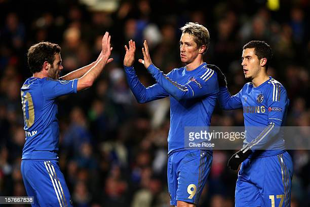Fernando Torres of Chelsea is congratulated by teammates Juan Mata and Eden Hazard after scoring his team's second goal during the UEFA Champions...