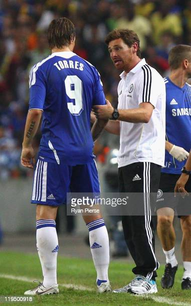 Fernando Torres of Chelsea is spoken to by Andre VillasBoas Manager of Chelsea during the preseason friendly match between Malaysia and Chelsea at...
