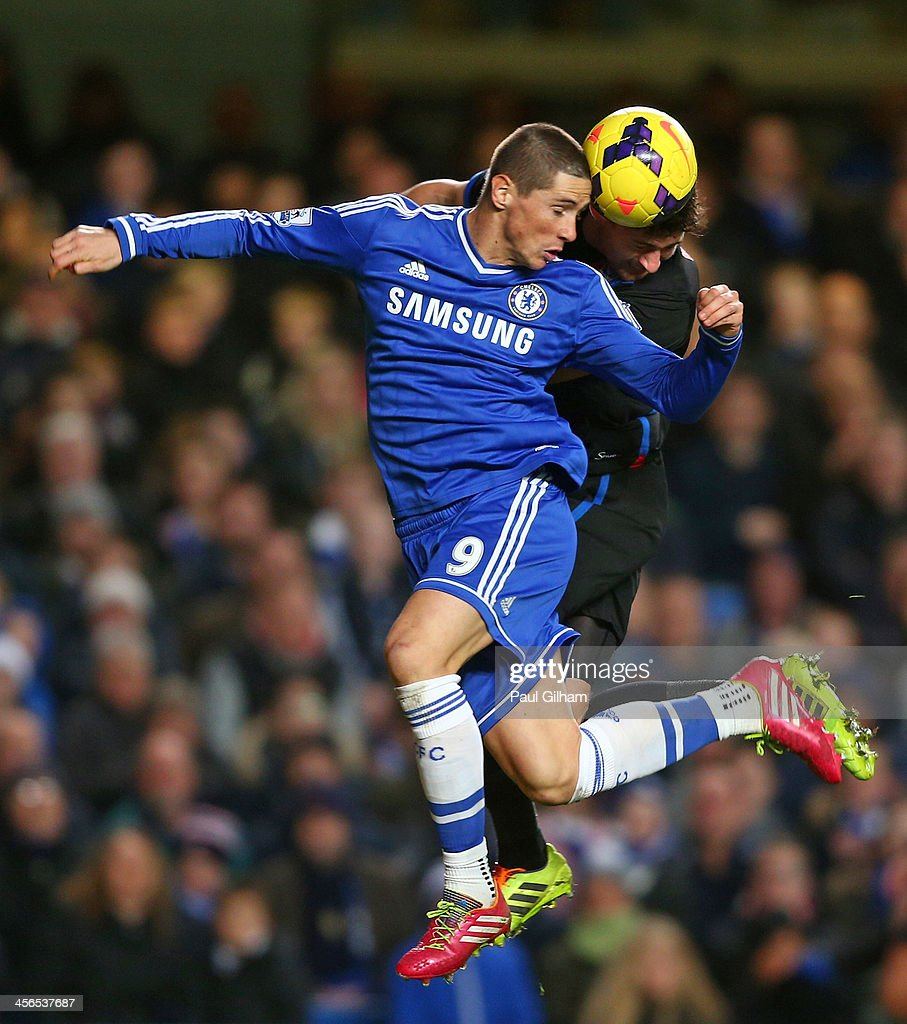 <a gi-track='captionPersonalityLinkClicked' href=/galleries/search?phrase=Fernando+Torres&family=editorial&specificpeople=194755 ng-click='$event.stopPropagation()'>Fernando Torres</a> of Chelsea jumps with Joel Ward of Crystal Palace during the Barclays Premier League match between Chelsea and Crystal Palace at Stamford Bridge on December 14, 2013 in London, England.