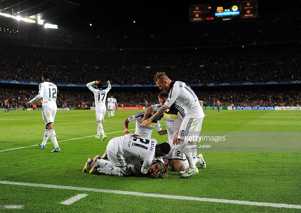 Fernando Torres (C) of Chelsea lays on the pitch celebrating with his teammates John Obi Mikel, Salomon Kalou, Branislav Ivanovic and Oriol Romeu after he scored during the UEFA Champions League Semi Final second leg match between FC Barcelona and Chelsea FC at the Camp Nou stadium on April 24, 2012 in Barcelona, Spain.