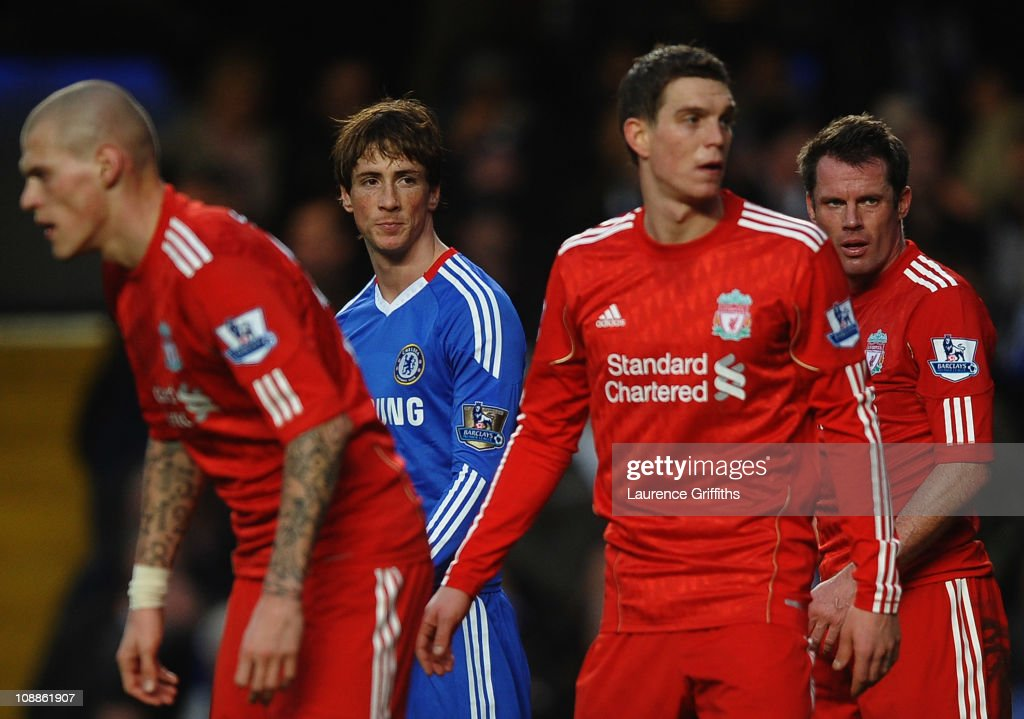 <a gi-track='captionPersonalityLinkClicked' href=/galleries/search?phrase=Fernando+Torres&family=editorial&specificpeople=194755 ng-click='$event.stopPropagation()'>Fernando Torres</a> of Chelsea looks across a Liverpool defenders <a gi-track='captionPersonalityLinkClicked' href=/galleries/search?phrase=Martin+Skrtel&family=editorial&specificpeople=5554576 ng-click='$event.stopPropagation()'>Martin Skrtel</a> (L), <a gi-track='captionPersonalityLinkClicked' href=/galleries/search?phrase=Daniel+Agger&family=editorial&specificpeople=605441 ng-click='$event.stopPropagation()'>Daniel Agger</a> (2R) and <a gi-track='captionPersonalityLinkClicked' href=/galleries/search?phrase=Jamie+Carragher&family=editorial&specificpeople=206485 ng-click='$event.stopPropagation()'>Jamie Carragher</a> )R) during the Barclays Premier League match between Chelsea and Liverpool at Stamford Bridge on February 6, 2011 in London, England.