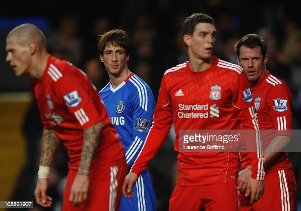 Fernando Torres of Chelsea looks across a Liverpool defenders Martin Skrtel Daniel Agger and Jamie Carragher R during the Barclays Premier League...