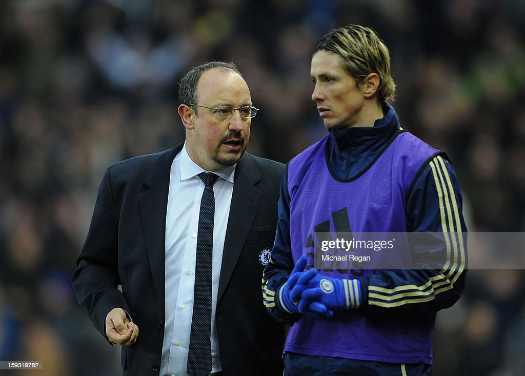 <a gi-track='captionPersonalityLinkClicked' href=/galleries/search?phrase=Fernando+Torres&family=editorial&specificpeople=194755 ng-click='$event.stopPropagation()'>Fernando Torres</a> of Chelsea receives instructions from Manager Rafael Benitez during the Barclays Premier League match between Stoke City and Chelsea at the Britannia Stadium on January 12, 2013, in Stoke-on-Trent, England.