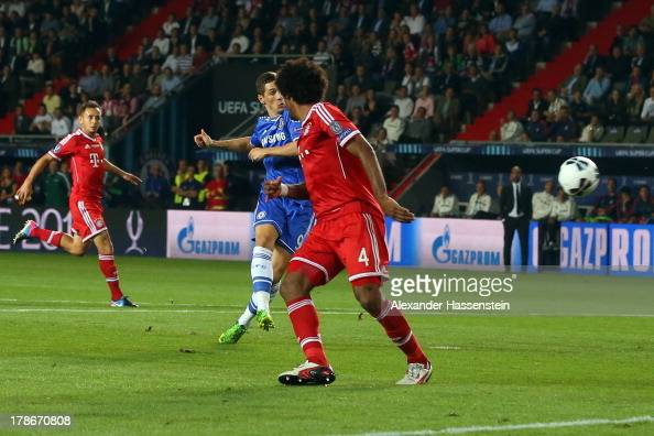 Fernando Torres of Chelsea scores the opening goal against Rafinha of Bayern Muenchen and his team mate Dante during the UEFA Super Cup between FC...