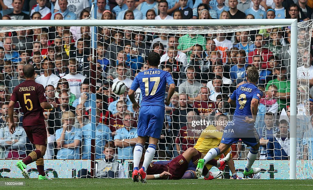 <a gi-track='captionPersonalityLinkClicked' href=/galleries/search?phrase=Fernando+Torres&family=editorial&specificpeople=194755 ng-click='$event.stopPropagation()'>Fernando Torres</a> of Chelsea scores the opening goal during the FA Community Shield match between Manchester City and Chelsea at Villa Park on August 12, 2012 in Birmingham, England.
