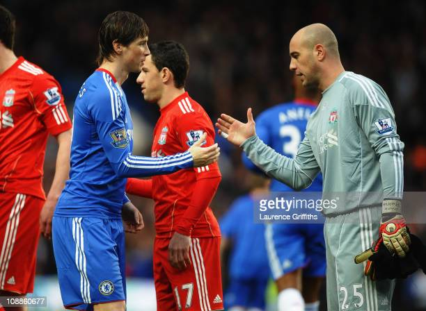 Fernando Torres of Chelsea shakes hands with former team mate Pepe Reina of Liverpool prior to the Barclays Premier League match between Chelsea and...
