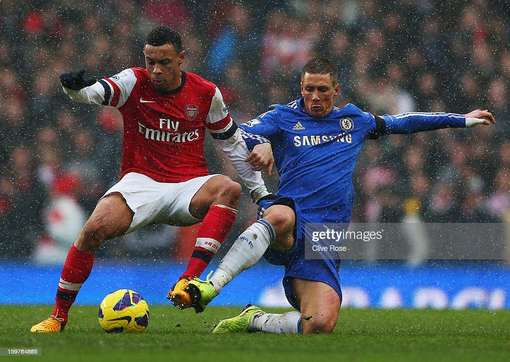 Fernando Torres of Chelsea tackles Francis Coquelin of Arsenal during the Barclays Premier League match between Chelsea and Arsenal at Stamford Bridge on January 20, 2013 in London, England.