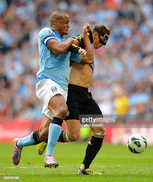 Fernando Torres of Chelsea tussles with Vincent Kompany of Manchester City in the box during the FA Cup with Budweiser Semi Final match between...