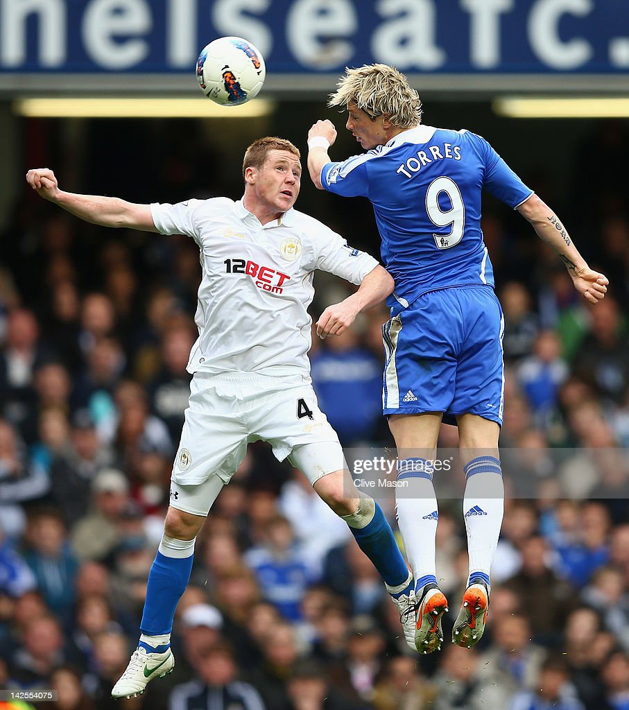 <a gi-track='captionPersonalityLinkClicked' href=/galleries/search?phrase=Fernando+Torres&family=editorial&specificpeople=194755 ng-click='$event.stopPropagation()'>Fernando Torres</a> of Chelsea wins a header against James McCarthy of Wigan Athletic during the Barclays Premier League match between Chelsea and Wigan Athletic at Stamford Bridge on April 7, 2012 in London, England.