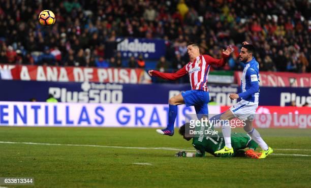 Fernando Torres of Club Atletico de Madrid beats Iago Herrerin of CD Leganes to score his team's 2nd goal during the La Liga match between Club...