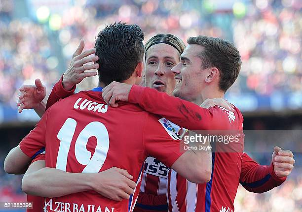 Fernando Torres of Club Atletico de Madrid celebrates with Antoine Greizmann and Lucas Hernandez after Atletico scored their opening goal during the...