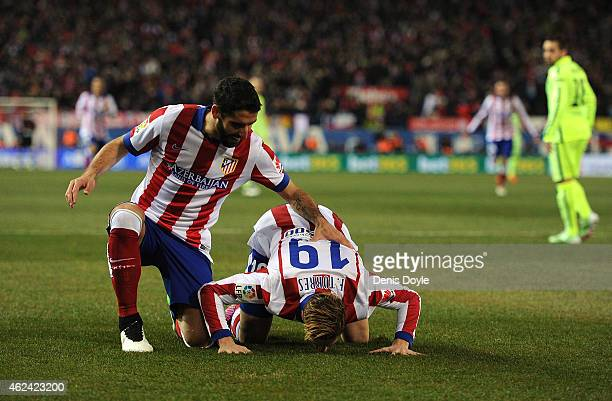 Fernando Torres of Club Atletico de Madrid celebrates with Raul Garcia after scoring his team's opening goal during the Copa del Rey Quarter Final...