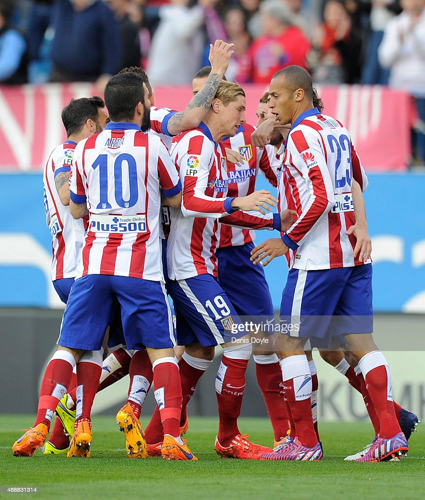 Fernando Torres of Club Atletico de Madrid celebrates with teammates after Mikel Gonzalez of Real Sociedad scored an own goal during the La Liga...