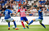 Fernando Torres of Club Atletico de Madrid duels for the ball with Hector Verdes of Real Oviedo during a pre season friendly match between Real...