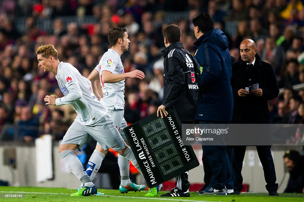 Fernando Torres of Club Atletico de Madrid substitutes his teammate Gabriel 'Gabi' Fernandez during the La Liga match between FC Barcelona and Club...