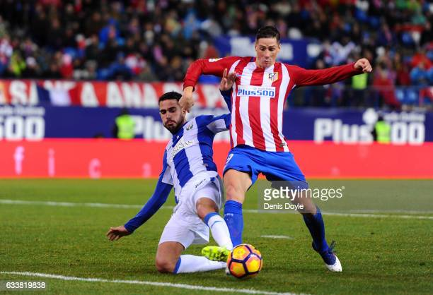 Fernando Torres of Club Atletico de Madridis tackled by Pablo Insua of CD Leganes during the La Liga match between Club Atletico de Madrid and CD...