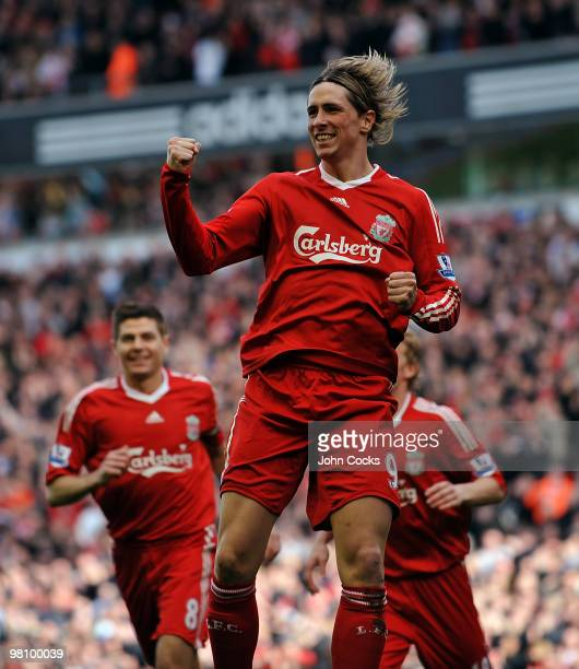 Fernando Torres of Liverpool celebrates after scoring a goal during the Barclays Premier League match between Liverpool and Sunderland at Anfield on...