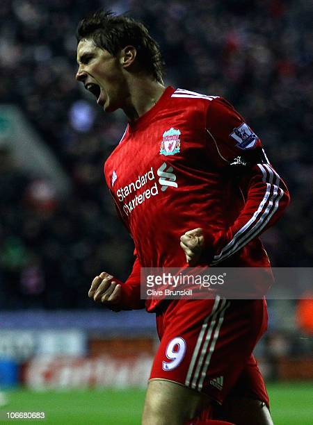 Fernando Torres of Liverpool celebrates after scoring the first goal during the Barclays Premier League match between Wigan Athletic and Liverpool at...