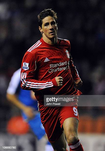 Fernando Torres of Liverpool celebrates after scoring the opening goal during the Barclays Premier League match between Wigan Athletic and Liverpool...