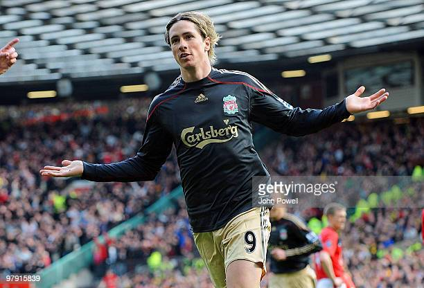 Fernando Torres of Liverpool celebrates after scoring the opening goal during the Barclays Premier League match between Manchester United and...