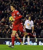 Fernando Torres of Liverpool celebrates his equalising goal to make it 11 during the Barclays Premier League match between Liverpool and Bolton...