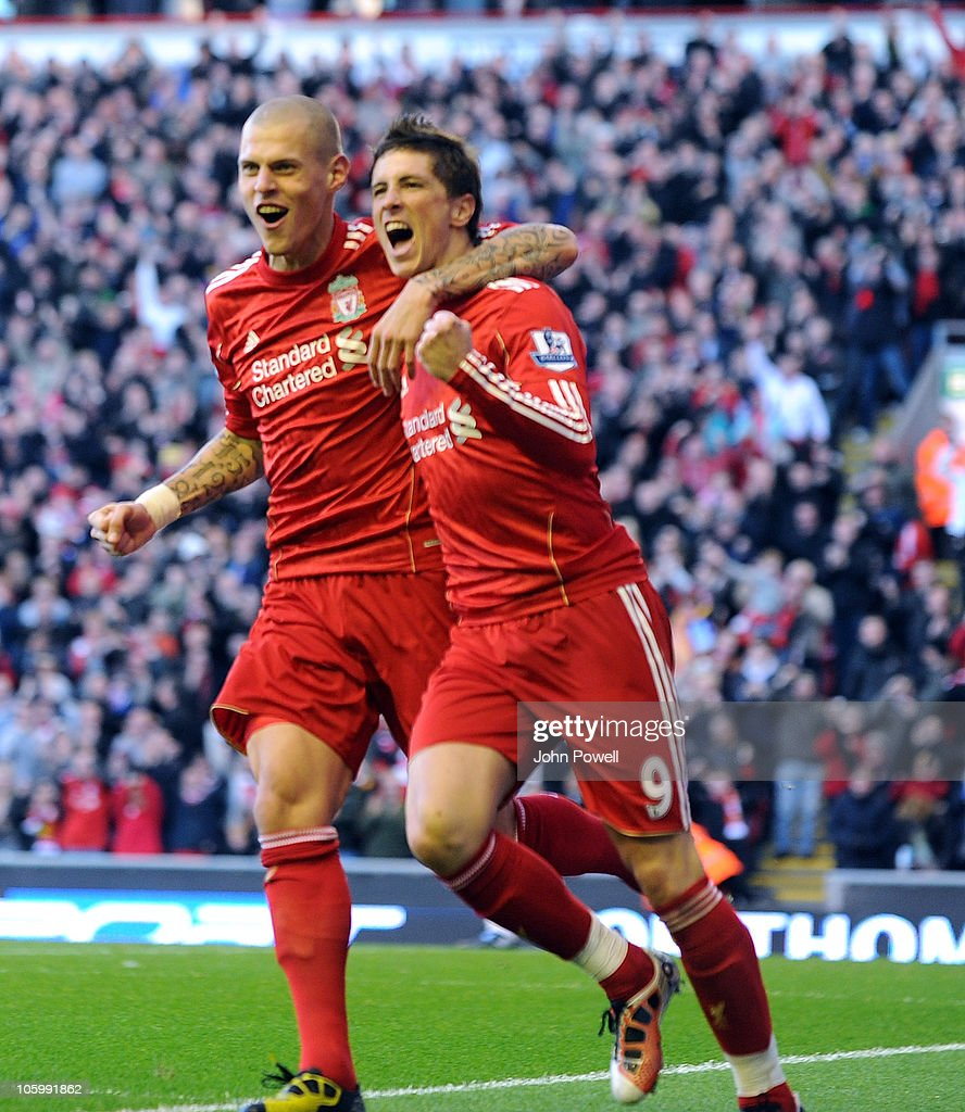 <a gi-track='captionPersonalityLinkClicked' href=/galleries/search?phrase=Fernando+Torres&family=editorial&specificpeople=194755 ng-click='$event.stopPropagation()'>Fernando Torres</a> of Liverpool celebrates his goal with <a gi-track='captionPersonalityLinkClicked' href=/galleries/search?phrase=Martin+Skrtel&family=editorial&specificpeople=5554576 ng-click='$event.stopPropagation()'>Martin Skrtel</a> of Liverpool during the Barclays premier league match between Liverpool and Blackburn Rovers at Anfield on October 24, 2010 in Liverpool, England.