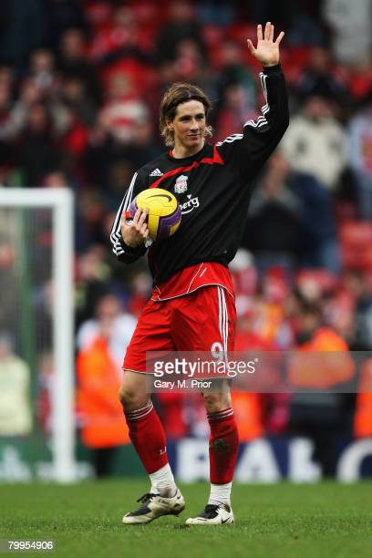 Fernando Torres of Liverpool celebrates his hatrick with the match ball after the Barclays Premier League match between Liverpool and Middlesbrough...