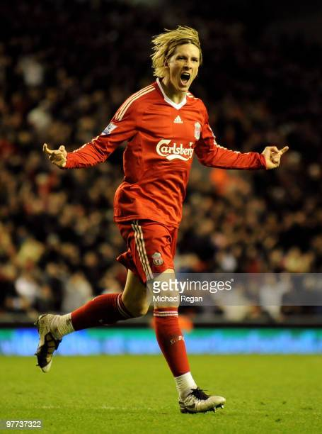 Fernando Torres of Liverpool celebrates scoring his team's fourth goal during the Barclays Premier League match between Liverpool and Portsmouth at...