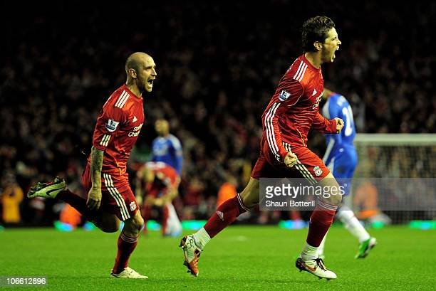 Fernando Torres of Liverpool celebrates scoring his team's second goal with team mate Raul Meireles during the Barclays Premier League match between...