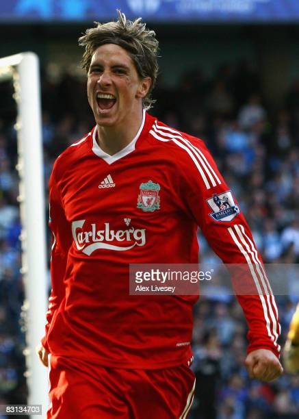 Fernando Torres of Liverpool celebrates scoring his team's second goal during the Barclays Premier League match between Manchester City and Liverpool...