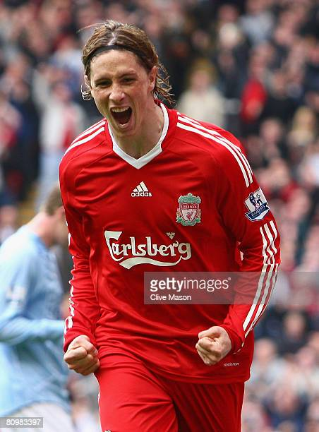 Fernando Torres of Liverpool celebrates scoring the opening goal during the Barclays Premier League match between Liverpool and Manchester City at...