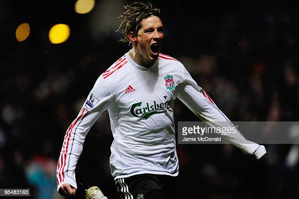 Fernando Torres of Liverpool celebrates scoring the opening goal during the Barclays Premier League match between Aston Villa and Liverpool at Villa...