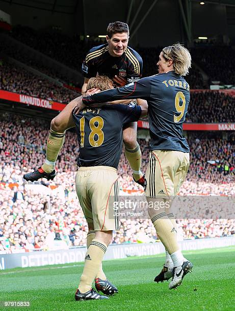 Fernando Torres of Liverpool celebrates with team mates Dirk Kuyt and Steven Gerrard after scoring the opening goal during the Barclays Premier...