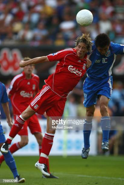 Fernando Torres of Liverpool challenged by Li Wei Feng during the Port of Rotterdam Tournament match between Liverpool and Shanghai Shenhua FC at the...